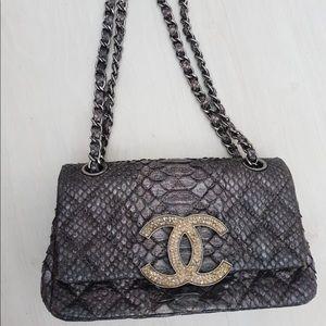 213a661cd8ba CHANEL. Chanel Python New Mini Bag ...